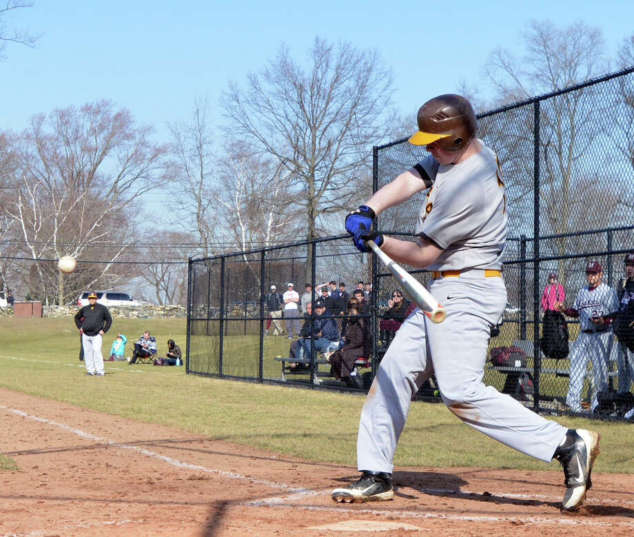 Brunswick's Ryan Popp hits a three-run home run in the bottom of the 3rd inning in the high school baseball game between Brunswick School and Hopkins School at Brunswick School in Greenwich, Wednesday, April 2, 2014. Brunswick defeated Hopkins, 8-2, with Brunswick's Bradley Wilpon getting the win. Photo: Bob Luckey / Greenwich Time