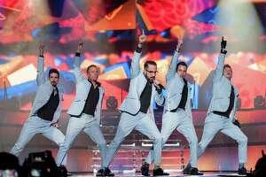 BIRMINGHAM, UNITED KINGDOM - MARCH 26: Kevin Richardson, Howie Dorough, Alexander James McLean, Brian Littrell and Nick Carter of Backstreet Boys perform on stage at LG Arena on March 26, 2014 in Birmingham, United Kingdom.