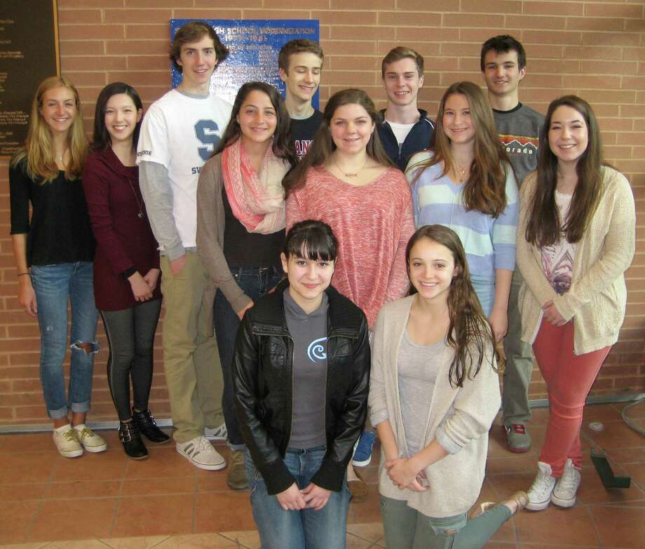 STAPLES CITES A BAKER'S DOZEN Staples High School has honored 13 students as its Students of the Month for April. Each month, the school cites a group of students who fulfill all of theIR responsibilities and contribute to the school community but otherwise might not get recognition. Aprilís honorees are, front row, from left: Zoe Feygin and Blair Gould. Middle row: Kaila Finn, Diana Zogheb, Jane Levy and Isabelle Chaple. Back row: Natalie Pulvino, Monique Medina, John Wisniewski, Clayton Hughes, Patrick Beusse and James Rubin. Abbey Fernandez also was honored but was not present for the photo. Photo: Westport News/Contributed Photo / Westport News