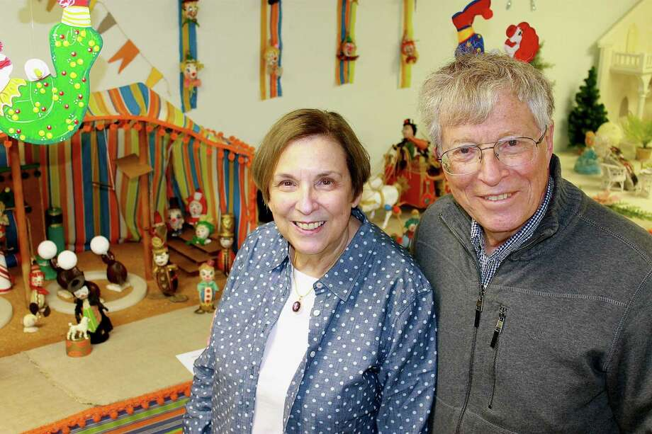 Berna and Joseph Heyman pose in front of a circus display, part of the Mildred Vrooman Easter Egg Collection, in Schoharie. The Heyman's are opening the collection to the public to benefit the Schoharie Free Library. (Christopher Lisio)
