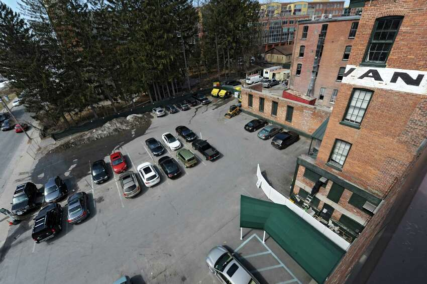 Rear exterior, taking from the roof, of the more than 160-year-old Rip Van Dam hotel on Wednesday, April 2, 2014 in Saratoga Springs N.Y. The owners will be renovating 16 rooms of the hotel and adding a 160-room hotel and five-story parking garage to the downtown area. The new part of the hotel will be built where this parking lot is now. (Lori Van Buren / Times Union)