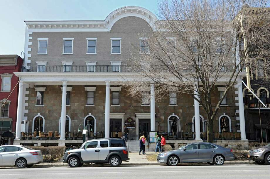 Exterior of the more than 160-year-old Rip Van Dam hotel on Wednesday, April 2, 2014 in Saratoga Springs  N.Y. The owners will be renovating 16 rooms of the hotel and adding a 160-room hotel and five-story parking garage to the downtown area. (Lori Van Buren / Times Union) Photo: Lori Van Buren / 00026349A