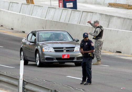 Vehicles are checked outside of the Bernie Beck Gate, Wednesday, April 2, 2014, in Fort Hood, Texas. One person was killed and 14 injured in a shooting at Fort Hood, and officials at the base said the shooter is believed to be dead. Photo: Deborah Cannon, Associated Press / American-Statesman