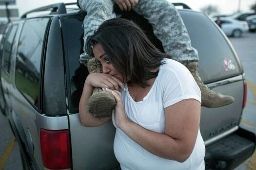 Lucy Hamlin and her husband, Spc. Timothy Hamlin wait for permission to re-enter the Fort Hood military base, where they live, following a shooting on base on Wednesday, April 2, 2014, in Fort Hood, Texas. One person was killed and 14 injured in the shooting, and officials at the base said the shooter is believed to be dead. The details about the number of people hurt came from two U.S. officials who spoke on condition of anonymity because they were not authorized to discuss the information by name. (AP Photo/Tamir Kalifa) Photo: Tamir Kalifa, Associated Press / FR170773 AP