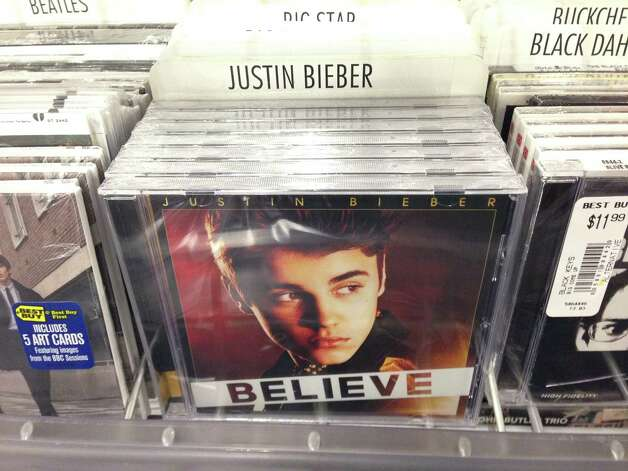 "In this image an album that appears to be Justin Bieber's ""Believe"" sits on the rack at the Best Buy in Culver City, Calif., Tuesday April 1, 2014. Paz, whose full name is Paz Dylan, a 25-year-old electronic musician and artist, says he's planted 5,000 copies of an album that appears to be Bieber's ""Believe"" but that actually contains a copy of his own CD in retailers such as Best Buy, Walmart and Target on April Fool's Day. This album turned out to be a copy of Paz's own CD. (AP Photo/Derrik J. Lang) ORG XMIT: NY107 Photo: Derrik J. Lang / ap"