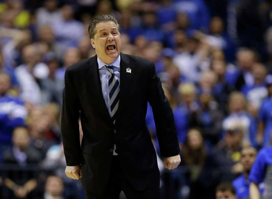 Kentucky head coach John Calipari yells during the second half of an NCAA Midwest Regional final college basketball tournament game against Michigan Sunday, March 30, 2014, in Indianapolis. (AP Photo/Michael Conroy)  ORG XMIT: INKS154 Photo: Michael Conroy / AP