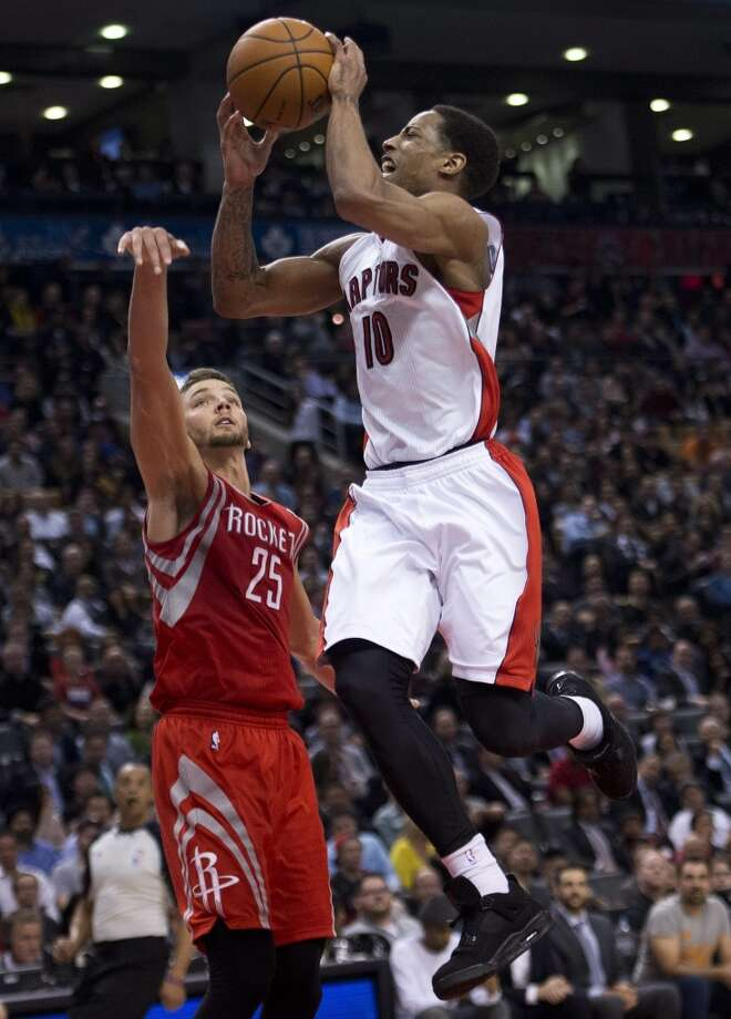 DeMar DeRozan of the Raptors attempts a shot against Chandler Parsons of the Rockets. Photo: Nathan Denette, The Associated Press/The Canadian Press