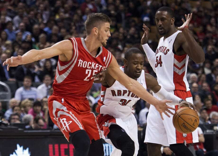 Rockets forward Chandler Parsons defends Terrence Ross of the Raptors. Photo: Nathan Denette, The Associated Press/The Canadian Press