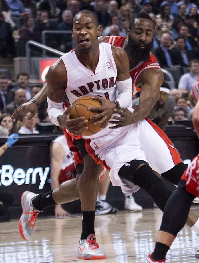 Terrence Ross of the Raptors gets past Rockets shooting guard James Harden. Photo: Nathan Denette, The Associated Press/The Canadian Press