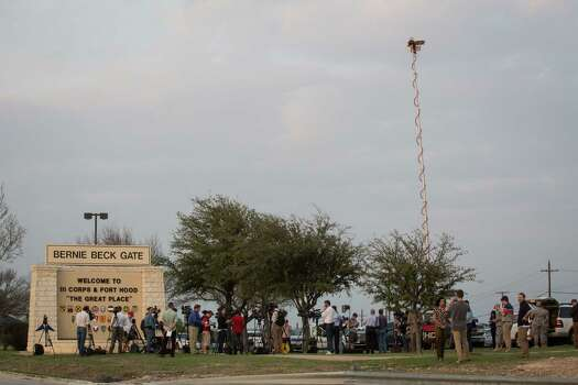 Members of the media wait outside of the Bernie Beck Gate, an entrance to the Fort Hood military base, for updates on a shooting that occurred inside on Wednesday, April 2, 2014 in Fort Hood, Texas. Photo: Tamir Kalifa, Associated Press / AP2014