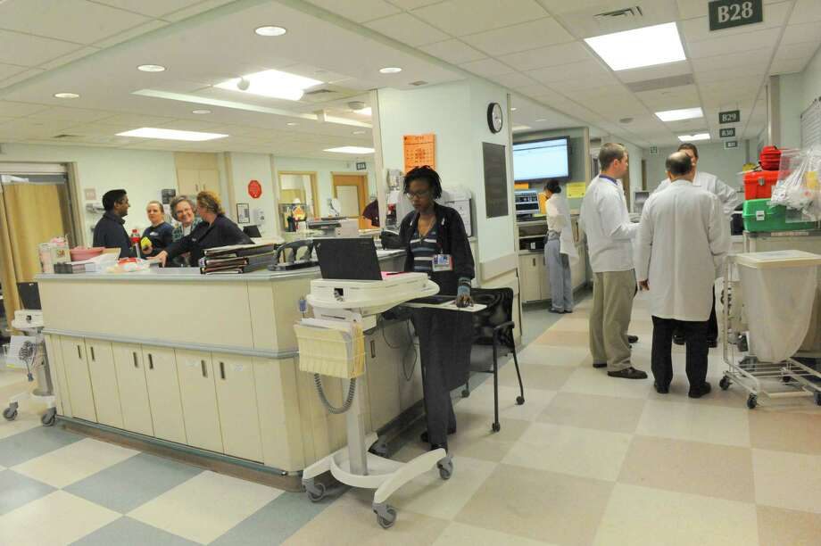 Emergency room staff work a busy afternoon shift Wednesday April 2, 2014, at Albany Medical Center in Albany, N.Y. Doctors and nurses in Albany Medical Center?s emergency room are feeling the effects of a statewide shortage of specialists every day. (Michael P. Farrell/Times Union) Photo: Michael P. Farrell / 00026356A