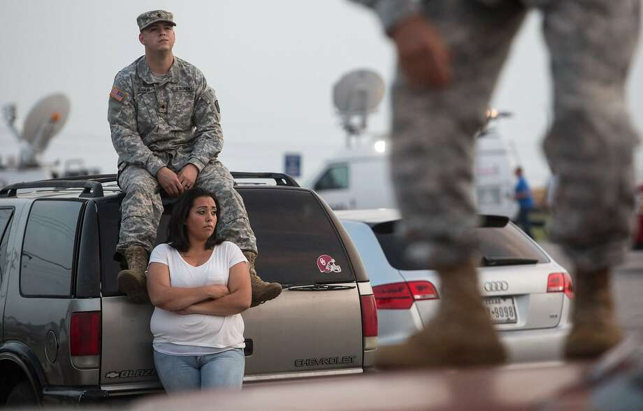 Lucy Hamlin and her husband, Spc. Timothy Hamlin, wait to return to their Fort Hood home. Photo: Tamir Kalifa, Associated Press