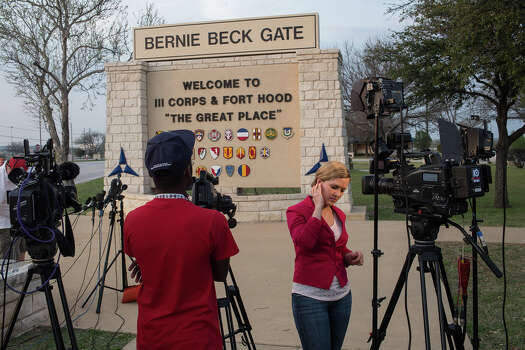 Members of the media wait outside of the Bernie Beck Gate, an entrance to the military base, for updates on a shooting that occurred inside on Wednesday, April 2, 2014, in Fort Hood, Texas. Photo: Tamir Kalifa, Associated Press / FR170773 AP