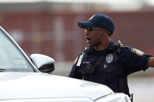 A Fort Hood Police Officer stops a vehicle near the main gate, Wednesday, April 2, 2014, as the military base was placed on lock down in Fort Hood, Texas. One person was killed and 14 injured in the shooting, and officials at Fort Hood said the shooter is believed to be dead. The details about the number of people hurt came from two U.S. officials who spoke on condition of anonymity because they were not authorized to discuss the information by name. Photo: Rusty Schramm, Associated Press / The Temple Daily Telegram