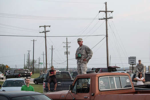 Military personnel and civilians wait in a parking lot outside of the Fort Hood military base for updates about the shooting that occurred inside on Wednesday, April 2, 2014, in Fort Hood, Texas. Photo: Tamir Kalifa, Associated Press / AP2014