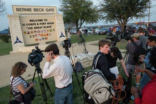 Members of the media wait outside of the Bernie Beck Gate, an entrance to the Fort Hood military base, for updates on a shooting that occurred inside on Wednesday, April 2, 2014, in Fort Hood, Texas. (AP Photo/Tamir Kalifa) Photo: Tamir Kalifa, Associated Press / FR170773 AP