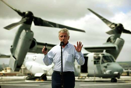 U.S. Secretary of Defense Chuck Hagel speaks during a news conference on the flight deck of the USS Anchorage (LPD-23), an amphibious transport dock ship, after a tour with his counterparts from Southeast Asia April 2, 2014 at Joint Base Pearl Harbor-Hickam in Honolulu, Hawaii. Secretary Hagel is in Hawaii to host a meeting of defense ministers from the Association of Southeast Asian Nations (ASEAN). A MV-22 Osprey tiltrotor V/STOL aircraft is in the background, (AP Photo/Alex Wong, Pool) Photo: Alex Wong, Associated Press / Pool Getty Images
