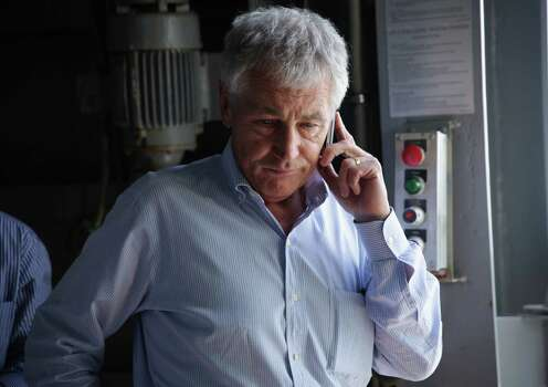 U.S. Secretary of Defense Chuck Hagel receives an update on the phone on the shooting at Fort Hood in Texas, as he was on a tour of the USS Anchorage, an amphibious transport dock ship, with his counterparts from Southeast Asia on Wednesday, April 2, 2014, at Joint Base Pearl Harbor-Hickam in Honolulu, Hawaii. (AP Photo/Alex Wong, Pool) Photo: Alex Wong, Associated Press / Pool Getty Images