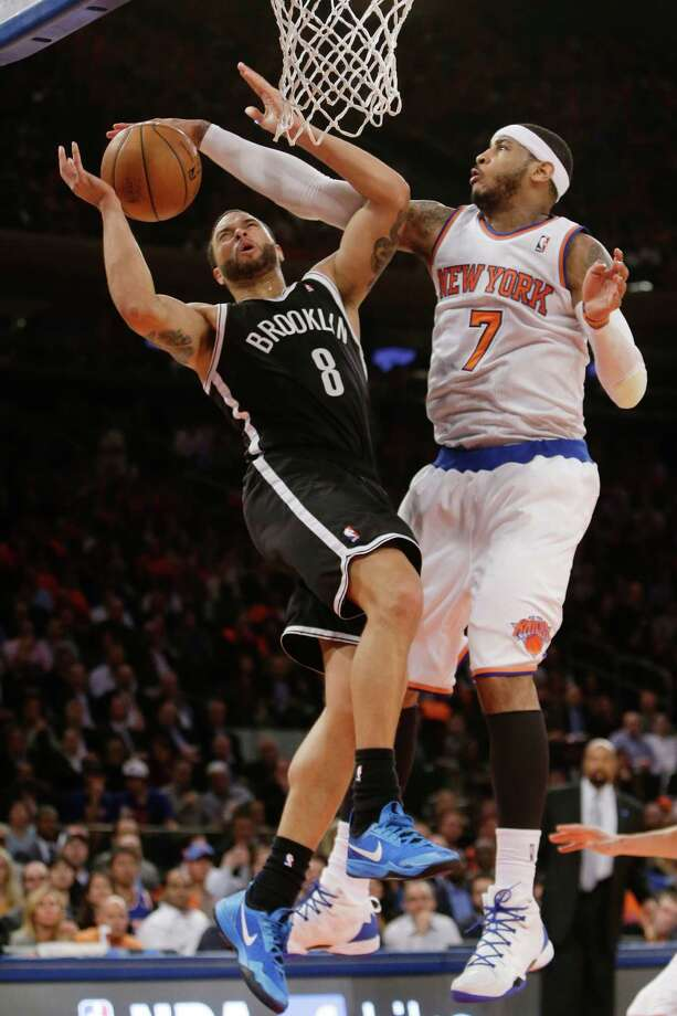 New York Knicks' Carmelo Anthony (7) blocks a shot by Brooklyn Nets' Deron Williams (8) during the second half of an NBA basketball game Wednesday, April 2, 2014, in New York. The Knicks won the game 110-81. (AP Photo/Frank Franklin II) ORG XMIT: MSG118 Photo: Frank Franklin II / AP