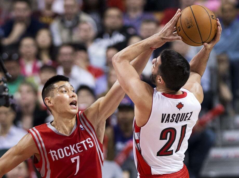 Rockets point guard Jeremy Lin defends a shot by Greivis Vasquez of the Raptors. Photo: Nathan Denette, The Associated Press/The Canadian Press