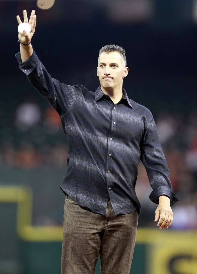 Former Astros and Yankees pitcher Andy Pettitte greets the crowd at Minute Maid Park. Photo: Melissa Phillip, Houston Chronicle