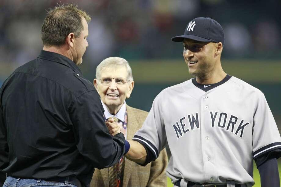 Yankees shortstop Derek Jeter with former teammate Roger Clemens. Photo: Melissa Phillip, Houston Chronicle