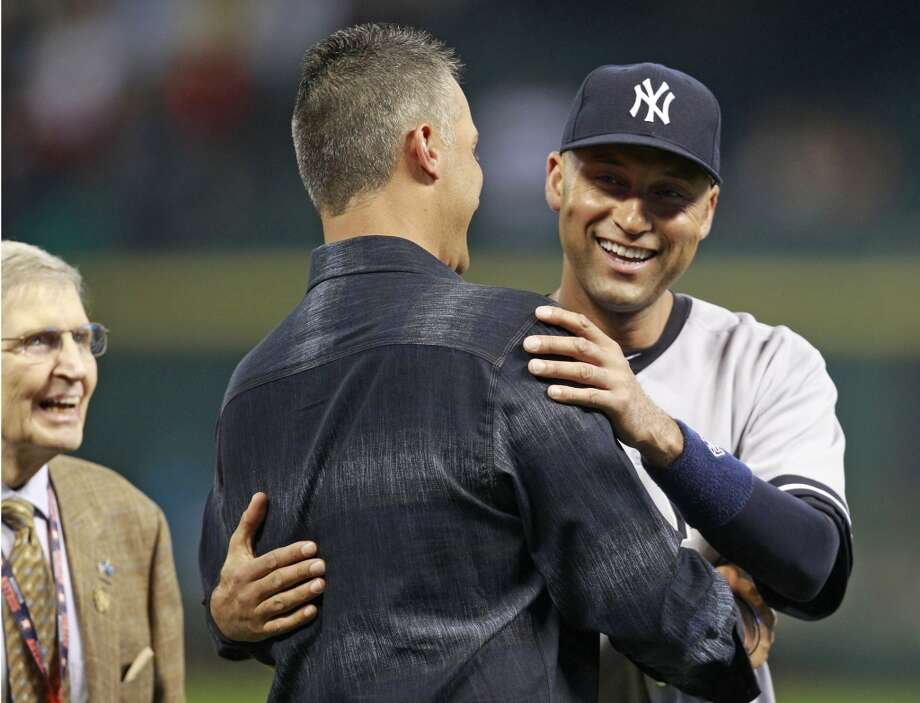 Yankees shortstop Derek Jeter embraces former teammate Andy Pettitte. Photo: Melissa Phillip, Houston Chronicle