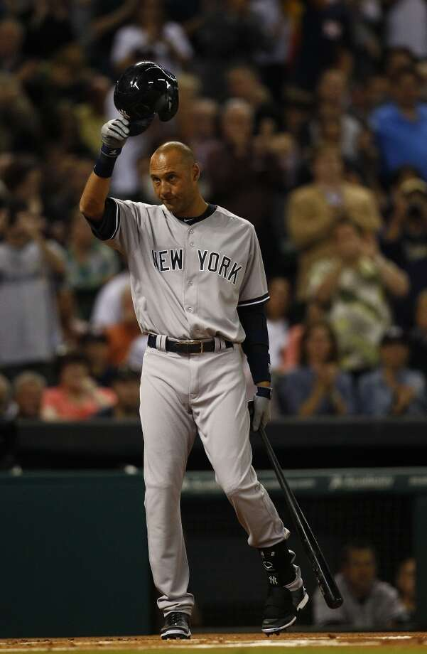 Yankees shortstop Derek Jeter acknowledges the crowd. Photo: Karen Warren, Houston Chronicle
