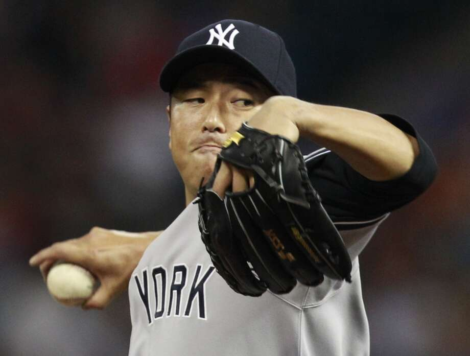 Yankees pitcher Hiroki Kuroda delivers a throw to the Astros. Photo: Melissa Phillip, Houston Chronicle