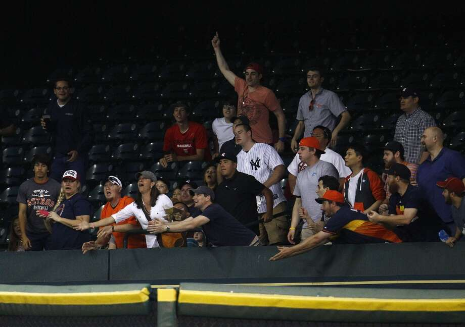 Fans prepare for Dexter Fowler's home run to reach the stands. Photo: Karen Warren, Houston Chronicle