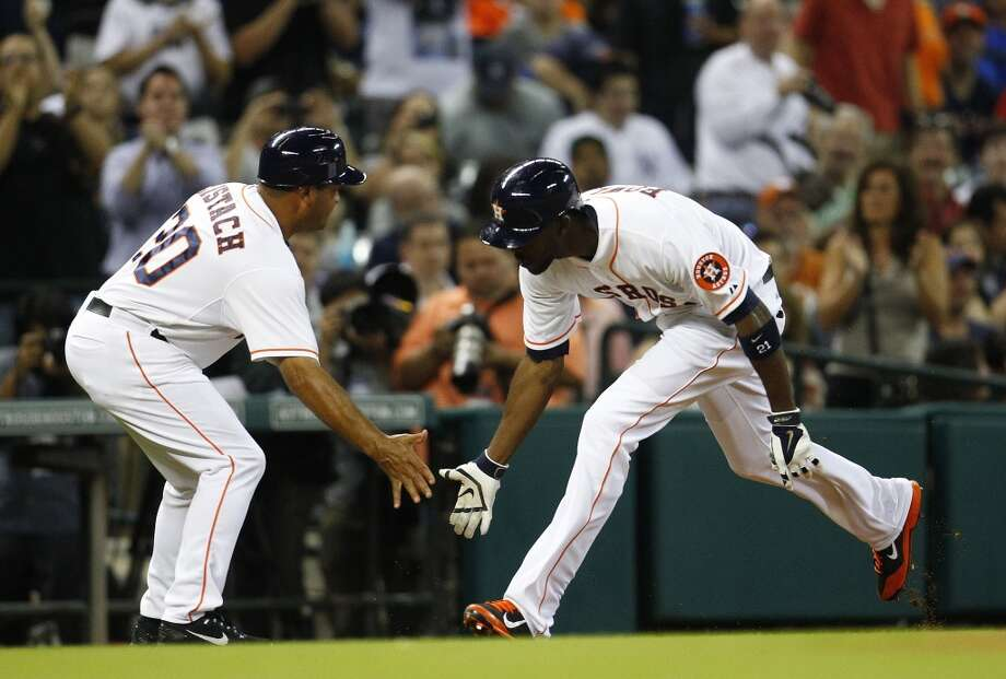 Astros third base coach Pat Listach congratulates Dexter Fowler for his home run. Photo: Karen Warren, Houston Chronicle