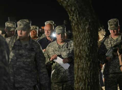Lt. Gen. Mark Milley, middle, leaves a press conference on Wednesday night, April 2, 2014, after speaking about the shootings that happened at Fort Hood in the afternoon of the same day. The gunman killed three fellow soldiers before fatally shooting himself. Photo: Billy Calzada, San Antonio Express-News / San Antonio Express-News