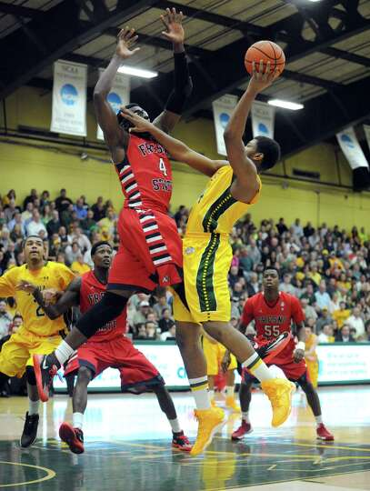 Siena's Lavon Long goes in for a basket defended by Fresno State's Karachi Edo during game two of th