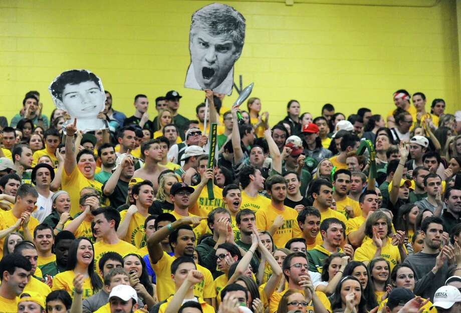 Siena students root on their team during game two of the College Basketball Invitational championship series against Fresno State at the ARC on Wednesday April 2, 2014 in Loudonville, N.Y. (Michael P. Farrell/Times Union) Photo: Michael P. Farrell / 00026315A