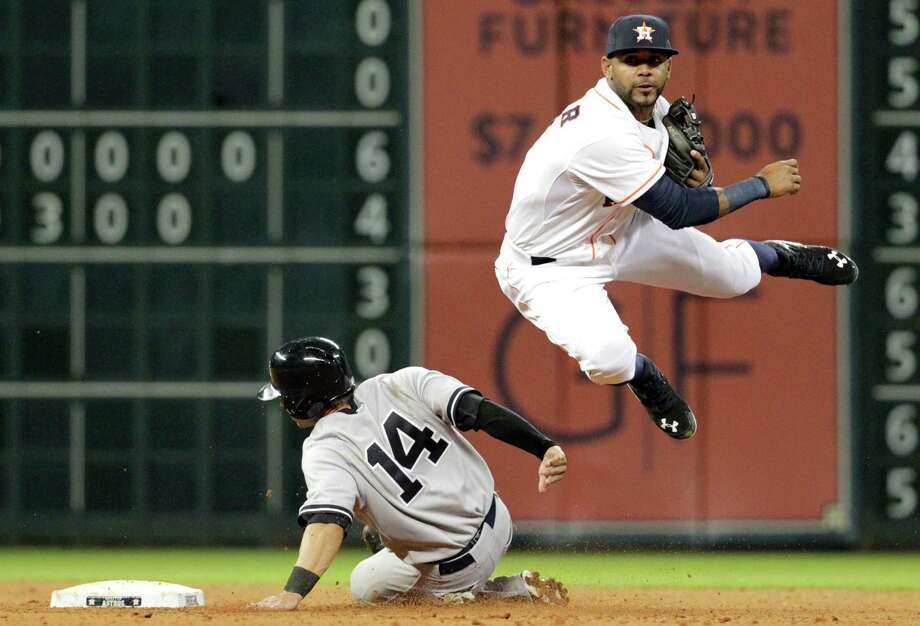 Houston Astros second baseman Jose Altuve completes a double play over New York Yankees' Brian Roberts (14) during the seventh inning of a baseball game, Wednesday, April 2, 2014, in Houston. (AP Photo/Patric Schneider)  ORG XMIT: TXPX114 Photo: Patric Schneider / FR170473 AP