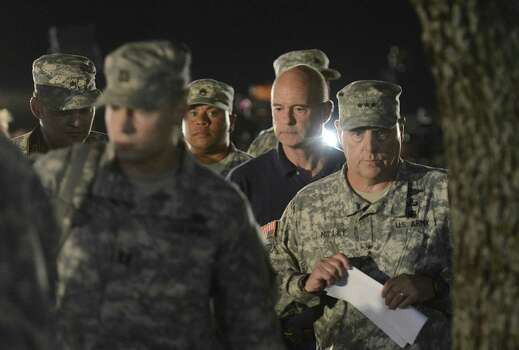 Lt. Gen. Mark Milley (right) leaves a news conference after addressing the news media about the shootings at Fort Hood. The gunman killed three fellow soldiers before fatally shooting himself. Photo: Billy Calzada / San Antonio Express-News / San Antonio Express-News