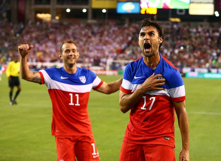 Chris Wondolowski (17), with Brad Davis approaching, celebrates after his first-half goal against Mexico gave the U.S. a 2-0 lead in an international friendly in Glendale, Ariz. Photo: Mark J. Rebilas, Reuters