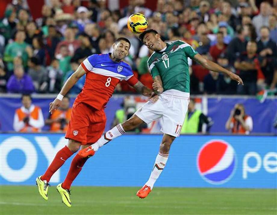 United States' Clint Dempsey fight for the ball against Mexico's Jesus Eduardo Zavala during an international friendly soccer match, Wednesday, April 2, 2014, in Glendale, Ariz. (AP Photo/The Arizona Republic, David Kadlubowski) Photo: David Kadlubowski, AP / The Arizona Republic