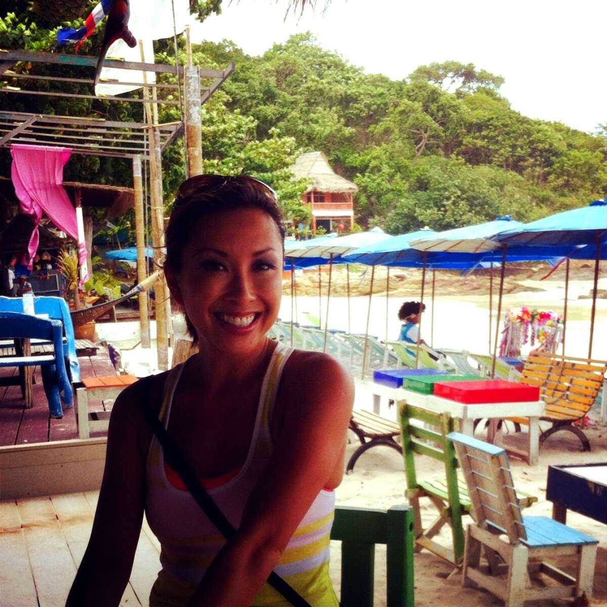 """KHOU anchor Lily Jang: """"Backpack through a new country. Talk to perfect strangers. Learn a new language. Discover a world of endless life lessons. I have never found the author but I live by his/her quote: Traveling is the only thing you can buy that makes you richer."""" (This photo was taken in Ko Samet, Thailand, June 2012)."""