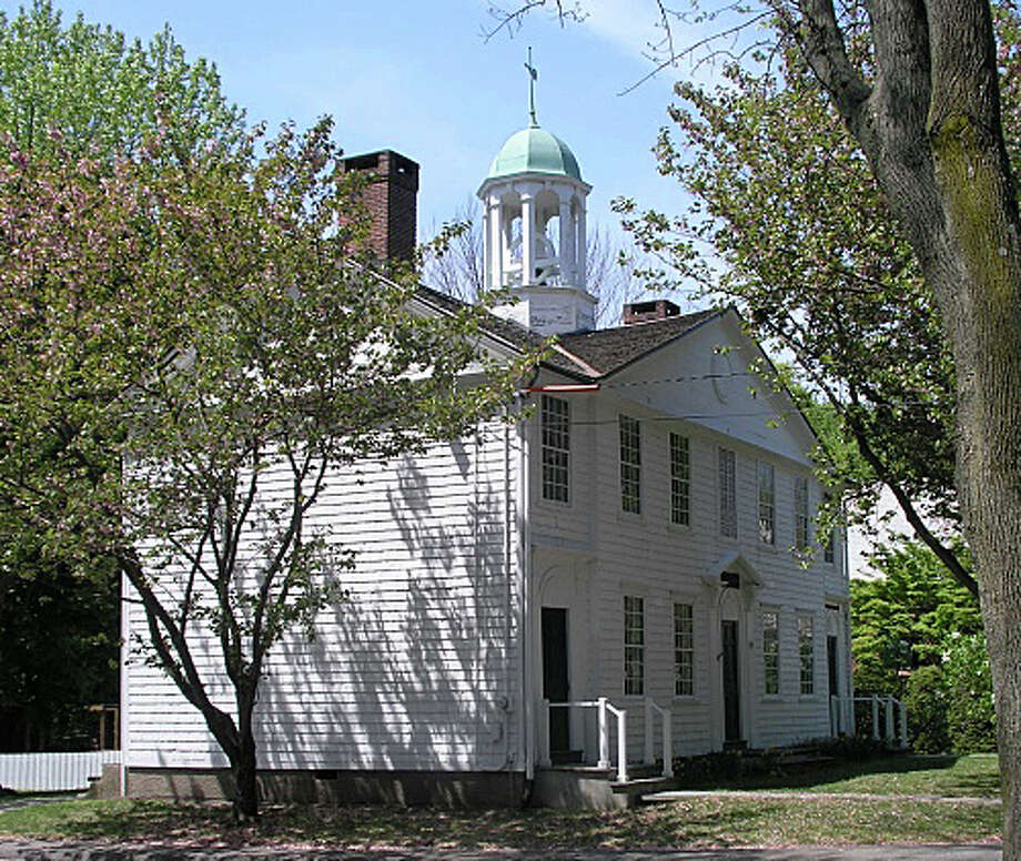 The Old Academy building on Town Hall Green will be rededicated April 12 following renovations by the Eunice Dennie Burr Chapter of the Daughters of the American Revolution. Photo: Contributed Photo / Fairfield Citizen
