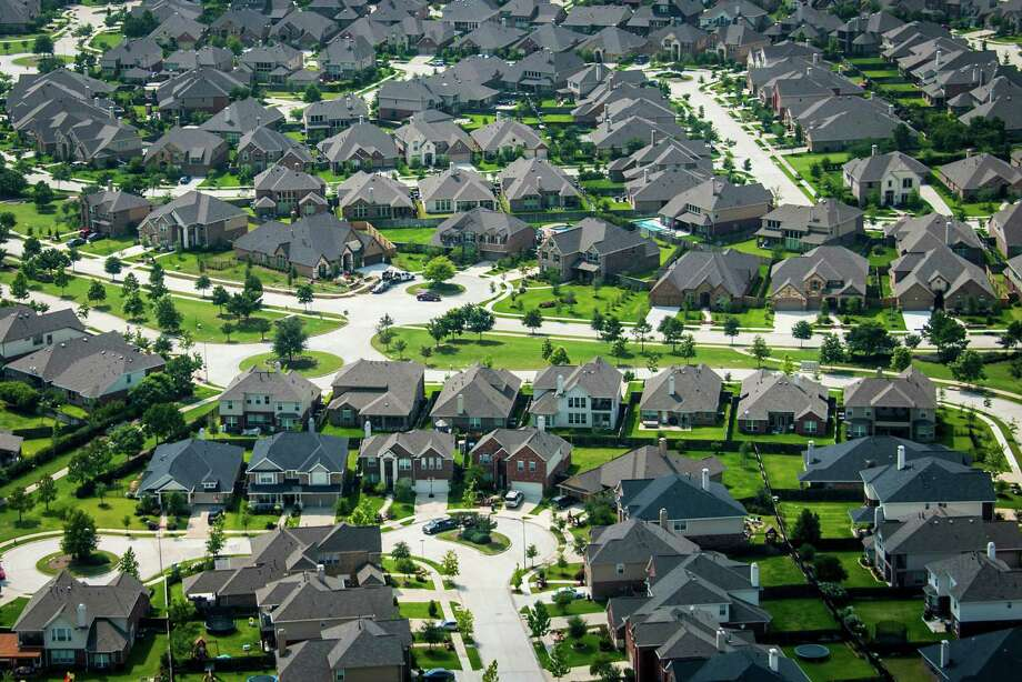 Houston is home to many low-density, single-family subdivisions, like this one in Cypress. But a new report shows that the city has neighborhoods as dense as Chicago or Newark. Photo: Smiley N. Pool, Houston Chronicle / © 2013  Houston Chronicle