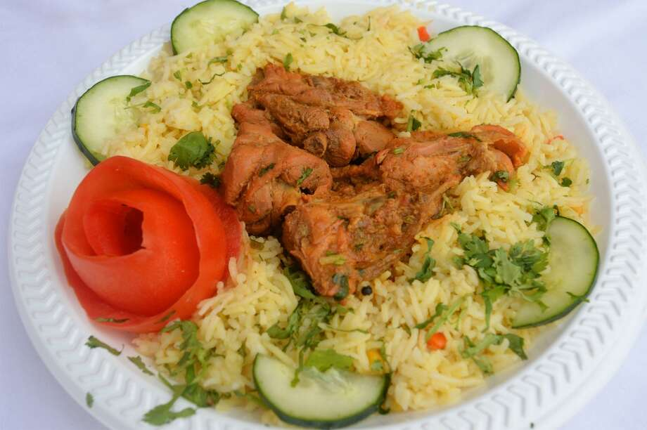 Chicken curry and rice at Taste of India at the South Texas State Fair. Photo taken Friday, March 28, 2014 Guiseppe Barranco/@spotnewsshooter