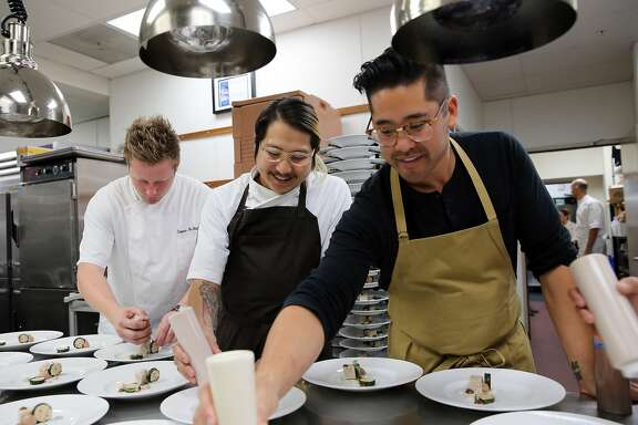 Thomas McNaughton of Flour + Water, Danny Bowien of Mission Chinese Food and Brandon Jew (left to right) work on plating a dish while participating in the James Beard Foundation's Taste America benefit dinner at the St. Regis in San Francisco, Calif., on Friday, October 4, 2013.