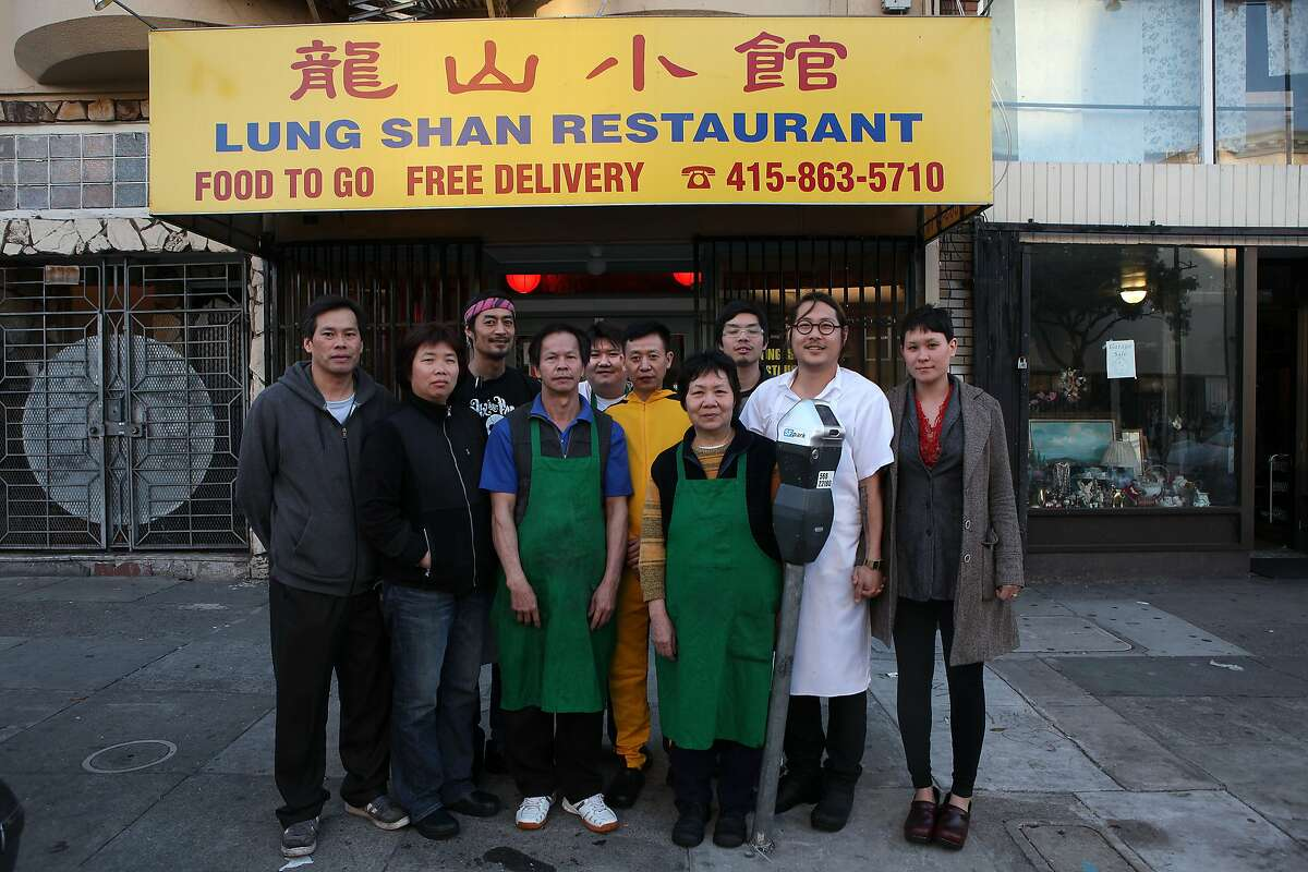 The Mission Chinese Food restaurant staff pose in front of their restaurant in San Francisco. 2011.
