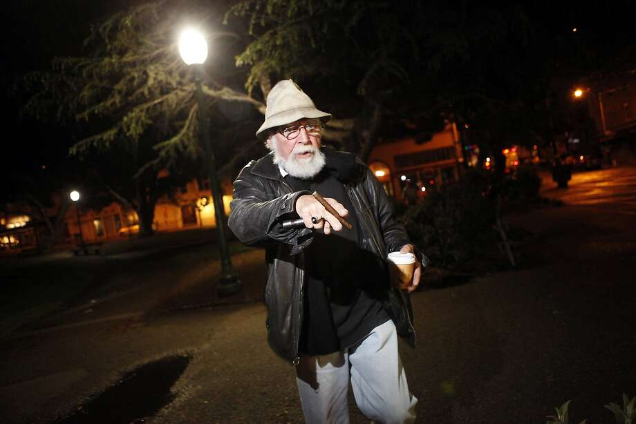 John Murnin searches Washington Square Park for signs of rats. Photo: Michael Short, The Chronicle