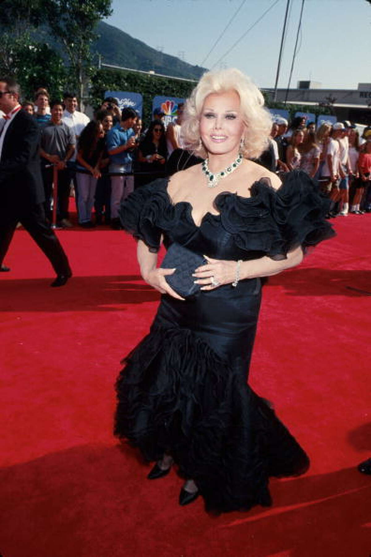 Actress Zsa Zsa Gabor wearing black gown.
