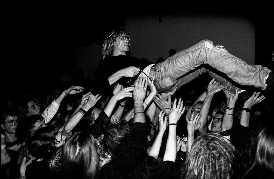 Singer and guitarist with Nirvana, Kurt Cobain performs live on stage in Frankfurt, Germany in 1991. Photo: Paul Bergen, Redferns / 1991 Paul Bergen