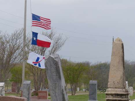 The flag flies at half mast at the Killeen City Cemetery on the morning after four Ft. Hood soldiers died in an incident on post. April 3, 2014. Photo: Billy Calzada, San Antonio Express-News / San Antonio Express-News