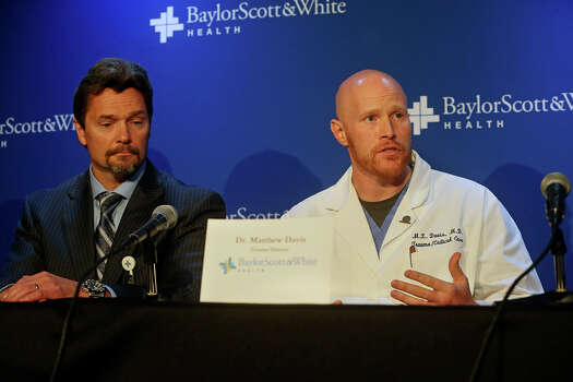 Dr. Matthew Davis (right) describes injuries with Dr. Stephen Sibbitt listening as administrators and medical staff speak at a news conference about the Ft. Hood shooting victims being treated at Scott and White Hospital in Temple, Texas  on April 3, 2014. Photo: TOM REEL
