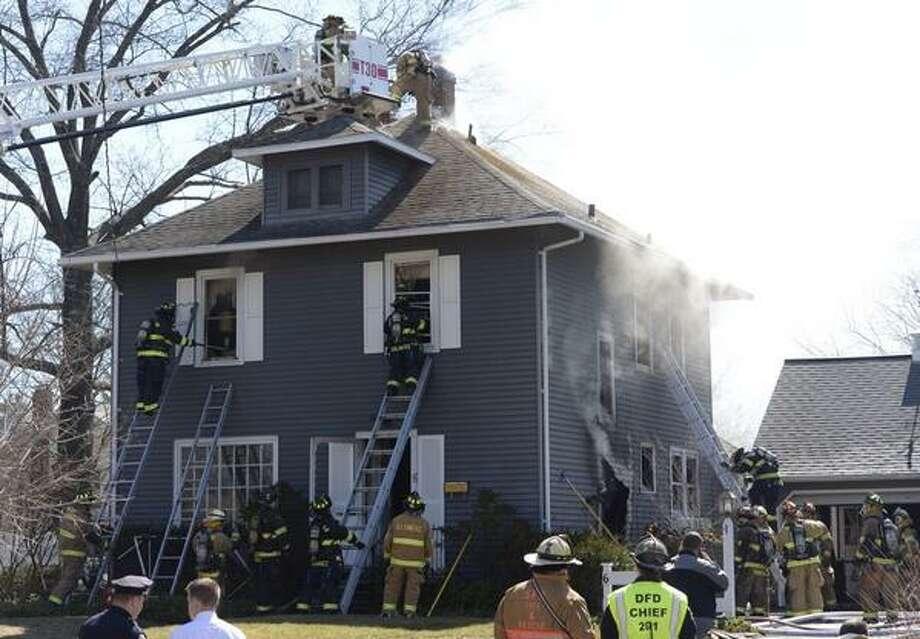 Firefighters battle a blaze that damaged a home at 6 Adams Place in Bethlehem on Thursday, April 3, 2014. (Skip Dickstein / Times Union)
